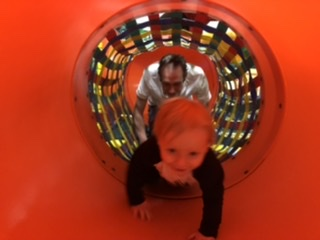 Robbie and Dad going through the maze of tunnels at Rascal Play in Clacton